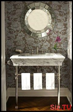 Gorgeous small powder room with blue & gray floral wallpaper, Two's Company Ainsworth Mirror, marble 2 leg washstand and wood floors in herringbone pattern. Powder Room Vanity, Powder Rooms, Small Room Decor, Contemporary Design, Contemporary Bathrooms, Connecticut, Bathroom Ideas, Vanity Bathroom, Bathroom Wallpaper