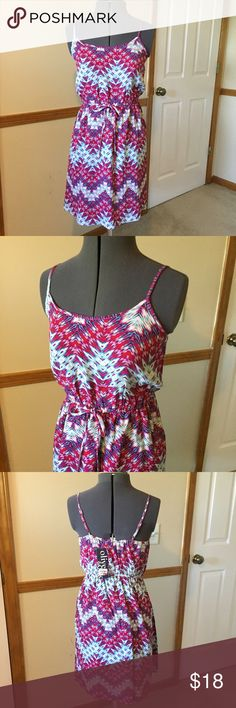 "Olive & Oak Sundress- NWTs! Olive & Oak Sundress- NWTs! Unique chevron and Aztec print in pinks, blues and purples. Size S measures flat: 16-20"" across chest, 13-20"" across waist, 22"" across hips, 33"" long. Has adjustable straps. 100% rayon. FM/072216 Olive & Oak Dresses Mini"