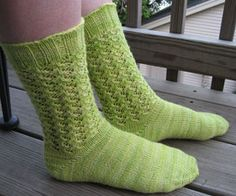 These socks are my first experiment in open work knitting in a sock pattern and my first pattern to feature toe up construction. I loved the subtle variations of the yarn that I chose, and thought they would combine well with a lace pattern because the variegations wouldn't be so strong that they would overwhelm the lace.