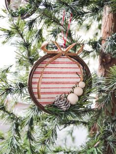 Handmade Christmas ornaments are so much fun to make! This DIY embroidery hoop Christmas ornament is easy to make and looks great in the tree!