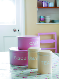 Transform tins into pretty storage with spray paint and stick on letters. We used Twist & Spray in Cameo Pink and Antique White. More great Kitchen ideas on Flickr!