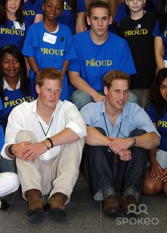 Prince William and Prince Harry sit and pose with children at a lunch party at Wembley Stadium