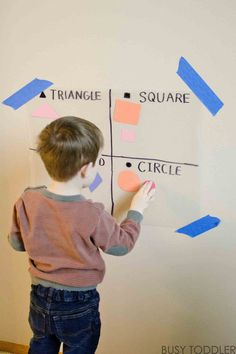 STICKY SHAPE WALL: A simple math activity for toddlers and preschoolers; a shapes activity; indoor math activity; homeshooling math lesson; shapes with toddlers