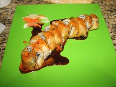My attempt at making deep fried sushi -  This one had spicy shrimp fried in tempura, crab, avocado, cucumber, carrots and drizzled with spicy sauce (I mixed mayo, soy sauce, Thai chili sauce, mirin & siriacha).  Then,  I dipped the entire roll in tempura batter, deep fried it and served with the spicy sauce and sweet eel sauce.  Turned out delicious!