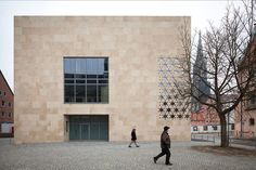 A freestanding, cuboid structure, this synagogue in Germany is signifcantly lower and more compact than its neighbors. Courtesy of: Yohan Zerdan