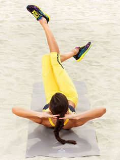The Scissors Crunch targets your abs and inner thighs.