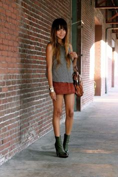 17 Ways to Wear Spring's Biggest Trend: The Brown Suede Skirt  | Blogger 'Sincerely Jules' wearing a brown suede mini skirt, sleeveless gray sweater, and platform ankle boots | StyleCaster.com