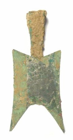 spade money from the Zhou Dynasty. There are no Chinese characters on it and the top is hollow as would be the case with a real shovel where you would insert a wooden handle. This type of pointed shoulder spade money was cast during the years 500-400 BC.This piece is approximately 142 mm in length and 66 mm at its maximum width. The actual weight is hard to determine because the hollow top portion is still packed with earth from having been buried.