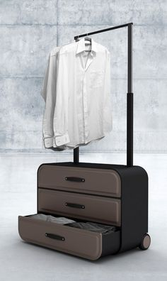 Traveller Closet by Psychic Factory is a suitcase concept that comes compartmentalized into drawers & its pulling handle extends to become a hanger rail.