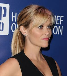 Reese has a peekaboo fringe that has been cut in a side parting to sweep over one eye. This is a universally flattering fringe type that adds instant interest to even the simplest style, like this classic ponytail. If you have one of these fringes, chances are you'll play with it a lot (constantly sweeping it to the side), so carry a miniature can of dry shampoo (Batiste, $4.99 is still one of the best) for quick touch-ups to add volume and absorb grease.