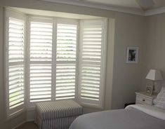 Indoor window shutters offers a unique design element to any decor. As an important protection aspect of the home, indoor window shutters are mostly for Bay Window Bedroom, Bay Window Shutters, Bedroom Shutters, White Shutters, Bedroom Blinds, Interior Shutters, Bedroom Windows, Blinds For Windows, Bay Windows