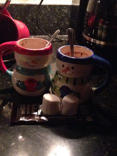 Me and Carly having hot chocolate and roasting marshmallows on the stove!