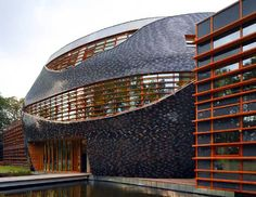 World Wildlife Fund Builds Carbon Neutral Headquarters Sustainable Architecture, Architecture Art, Thomas Rau, Frank Gehry, Spiral Staircase, Custom Homes, Sustainability, Door Frames, Wildlife