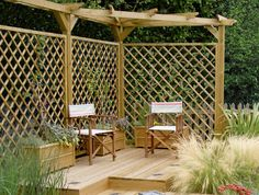 A Corner Pergolad and Diamond Trellis Panels #trellis #garden #home #design http://www.jacksons-fencing.co.uk/fencing/secret-garden-collection/trellis-premier-diamond/secret-garden-collection-trellis-premier-diamond.aspx?agid=597