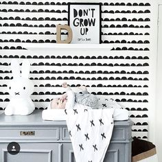Lifestyle - Practical Shot. Open nappy wallet on a change table with geometric + stylish nursery furniture. Maybe take away change table and have wallet on a chest of drawers with other baby items. Cool lamp etc.