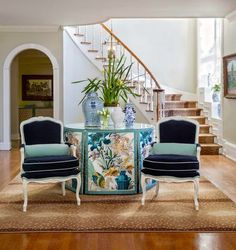 """I am absolutely obsessed with Brunschwig & Fils' """"Le Lac"""" fabric in the turquoise color way and it is used to perfection in panels on a skirted round table in this foyer by Melissa Haynes. The..."""