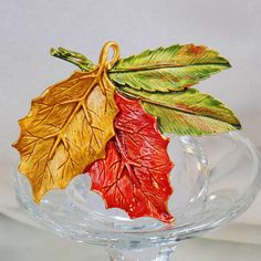 This #vintage autumn leaf brooch and pendant is really gorgeous!  It features two fall leaves enameled in shades of orange and golden yellow with two green and red leaves as... #ecochic #etsy #jewelry #jewellery
