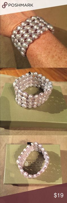 "Honora Gray Baroque Pearl Stretch Bracelet NWT This stylish stretch bracelet features silver Gray baroque pearls accented with tiny silver beads. Fits average size wrist. Pearls measure 8 mm. Bracelet measures 1 1/2"" wide. Price is firm unless bundled for discount. No trades. Honora Jewelry Bracelets"