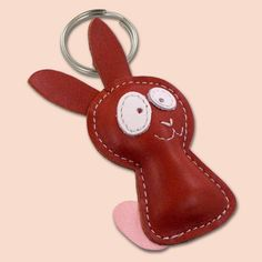 We were thinking long time about rabbit design. Even, our younger son, who adores rabbits, draw dozen drawings, and now we finally decided to make this one, based on one of his drawings.    This cute little rabbit keychain is completely made of 100% natural leather. Keychain is filled with cotton wool to get 3D look and soft touch. Dimensions of the rabbit are 5,5 x 9 cm (2.16 x 3.54 in).
