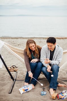 S'mores beach engagement photography session complete with hammocks and sweaters!