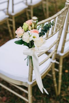 Gold Tiffany chairs and pastel flower decoration // Pastel Seaside Wedding at Beaulieu House: Victor and Huang Min