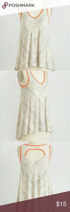 NWOT Super soft Vneck tank True to size. Has stretch to material. Super soft v-neck tank. Minor high low hem, slight open lace back at the top. Cream with light black print and coral trim. Never worn ModCloth Tops Tank Tops