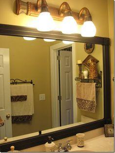 Great idea for dressing up plain bathroom mirror...