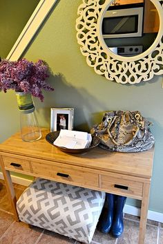 Nice idea for an entryway- looks like it's front of a staircase too, like ours.  Super cute mirror, too.