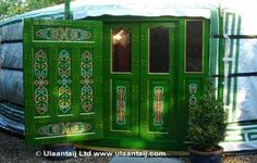 Green painted yurt doors. Mongolia