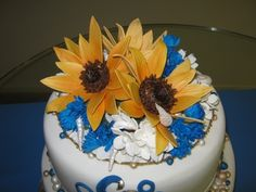 Anniversay/Wedding Vow Renewal Cake Topper. Gumpaste Sunflowers and Cornflowers plus a few seashells.