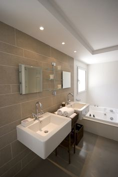 Awesome Deluxe Villa in a Contemporary Neutral Scheme : Luxury Villa In A Contemporary Neutral Scheme With White Brown Bedroom Wall Wash Basin Mirror Bathtub Lamp Window Towel Glass Cabinet Brown Ceramic Floor Shower And Lamp Design