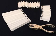 Easy Angel Crafts Accordian Folded Paper Angel Ornament Step 6 punch holes on one end