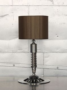 i love the use of a cruisers shocks and brake rotors to make a table lamp.  i had similar ideas but with using car parts instead of motorcycle parts
