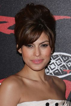 eva mendes hair updo | Actress Eva Mendes attends 'The Spirit' Paris Premiere on December 09 ...