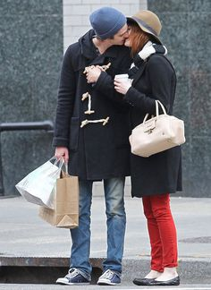 : Emma Stone gave Andrew Garfield a kiss on the streets of NYC in January 2012.
