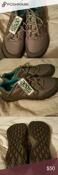 Merrell Sneakers Grey and aqua sneakers.   New with tags.  Excellent tread on the bottom.   Bundle and save!  Feel free to ask questions and make an offer using the offer button, but no low-balling please! Merrell Shoes Sneakers