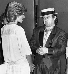 Princess Diana talks to Elton John on her arrival at Wembley Stadium for the start of the Live Aid in London, July 13, 1985.