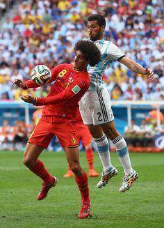 Marouane Fellaini of Belgium controls the ball against Ezequiel Garay of Argentina during the 2014 FIFA World Cup Brazil Quarter Final match between Argentina and Belgium at Estadio Nacional on July 5, 2014 in Brasilia, Brazil.