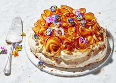 Peach 'flowers', Earl Grey syrup, peach curd rippled cream and crunchy hazelnut praline make for a stunning pavlova. Visit Sainsbury's to find out more