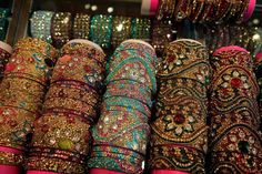 A trip to the vibrant bazaars of India is at the top of our summer wishlist! (via New York Times) Thread Bangles Design, Silk Thread Bangles, Bridal Bangles, Bridal Jewelry, Silver Bracelets, Bangle Bracelets, Healing Bracelets, New York Times, Hyderabadi Jewelry