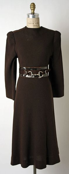Dress  Claire McCardell (American, 1905–1958)  Manufacturer: Townley Frocks (American) Date: 1938 Culture: American Medium: (a) wool (b) leather Dimensions: (a) Length: 47 in. (119.4 cm) (b) Length: 28 in. (71.1 cm) Credit Line: Gift of Claire McCardell, 1949 Accession Number: C.I.49.37.14a, b  This artwork is not on display