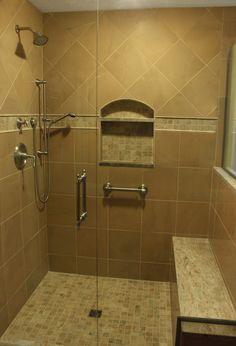 Bathroom remodel by Renovisions. Custom shower with seat and cubby. http://www.renovisionsinc.com