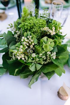 Weddings Flower Arrangements : green floral centerpiece by glasswing floral www. Rustic Wedding Centerpieces, Wedding Flower Arrangements, Christmas Centerpieces, Floral Centerpieces, Wedding Bouquets, Floral Arrangements, Wedding Flowers, Table Centerpieces, Woodland Theme