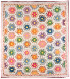 """Grandmother's Flower Garden"" quilt, made by Carrie Stetzler from 1931-1934 , during the Great Depression , in Geneva, Nebraska"
