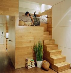 """Clever! """"According to architects, """"a bedroom loft creates space for a roomy walk-in closet below, while stair risers conceal a series of built-in drawers. --Jordan Parnass Digital Achitecture. Great guest or kid room"""