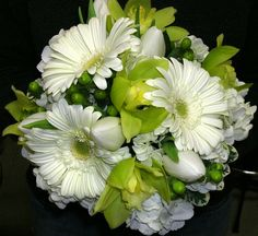 Wedding Flowers - Bridesmaid's bouquet of white gerbera, hyrdrangea and tulips, green orchids and berries. Available in different sizes starting at $100.00.