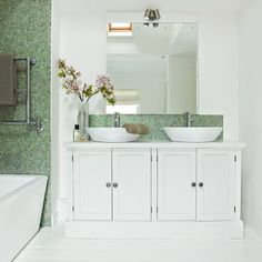 White bathroom with twin basins and green mosaic tiles | Bathroom decorating