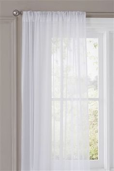 Cotton muslin voile curtains. Lets the air and light in, blocks the bad view.