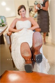 How cute is this?? Beautiful bride showing off her cowboy boots for her farm Wedding | Charlotte Ashley Photography
