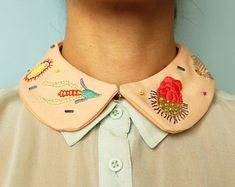 Collar with a simple embroidery pattern.